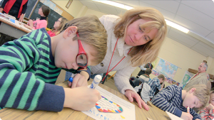 Sacred Heart, Bay Head, one of six Faith To Move Mountains pilot parishes, has invested some campaign funds in the parish's religious education program. Here, a catechist instructs a student during class. Video still
