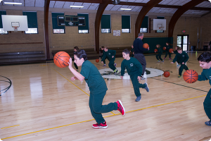 Students from St. Peter School, Point Pleasant Beach, play basketball during gym class. Funds raised through Faith To Move Mountains went toward replacing the gymnasium floor. Mike Ehrmann photo