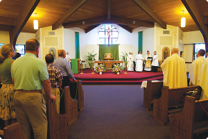 Holy Innocents Church, Neptune, celebrated the July 2013 installation of their pastor, Father Michael Wallack, and hopes to make building repairs with funds from Faith To Move Mountains. Jeff Metzner photo